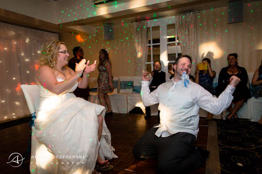 married couple having fun at their own wedding party