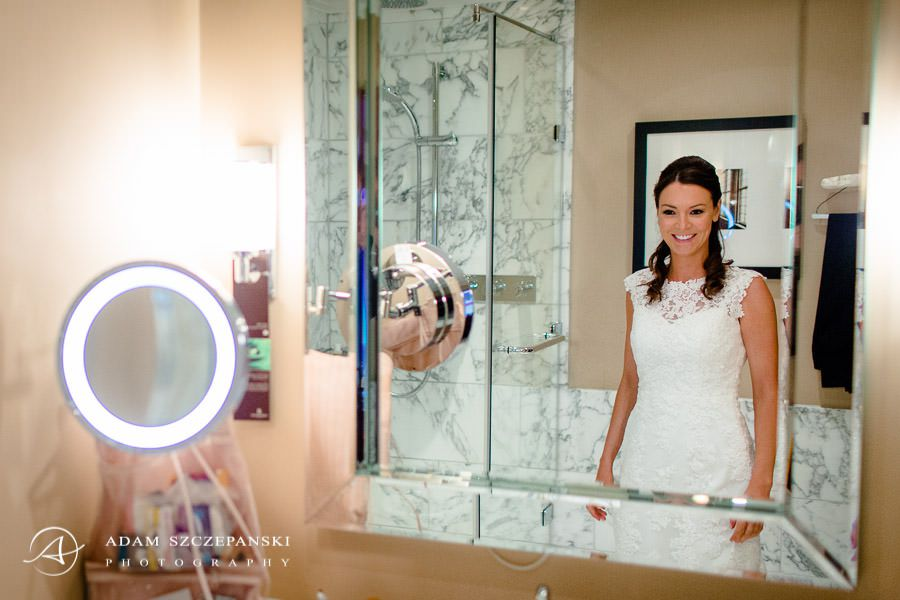 bride ann looks in the mirror