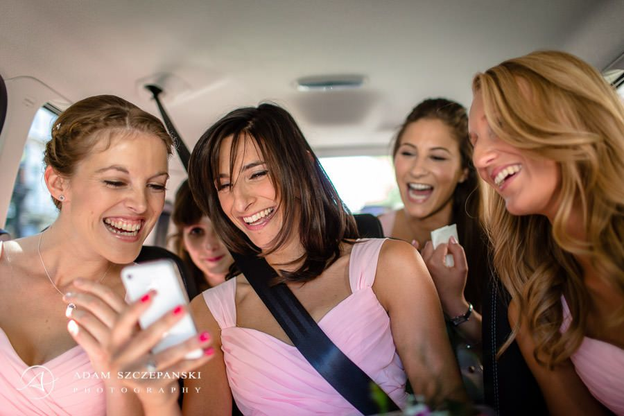 bridemaids laughing in the car