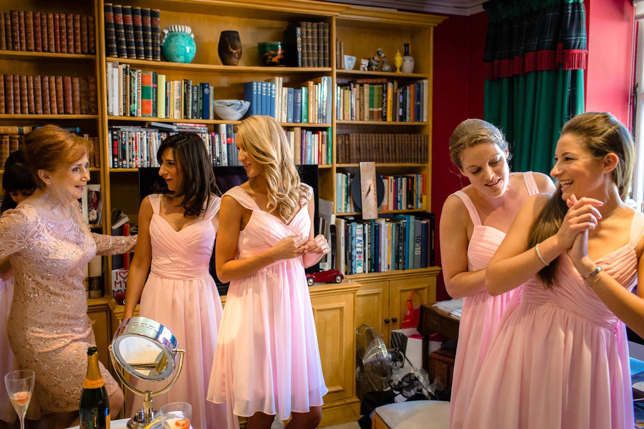 St. Pancras Renaissance hotel wedding bridesmaids helping each other