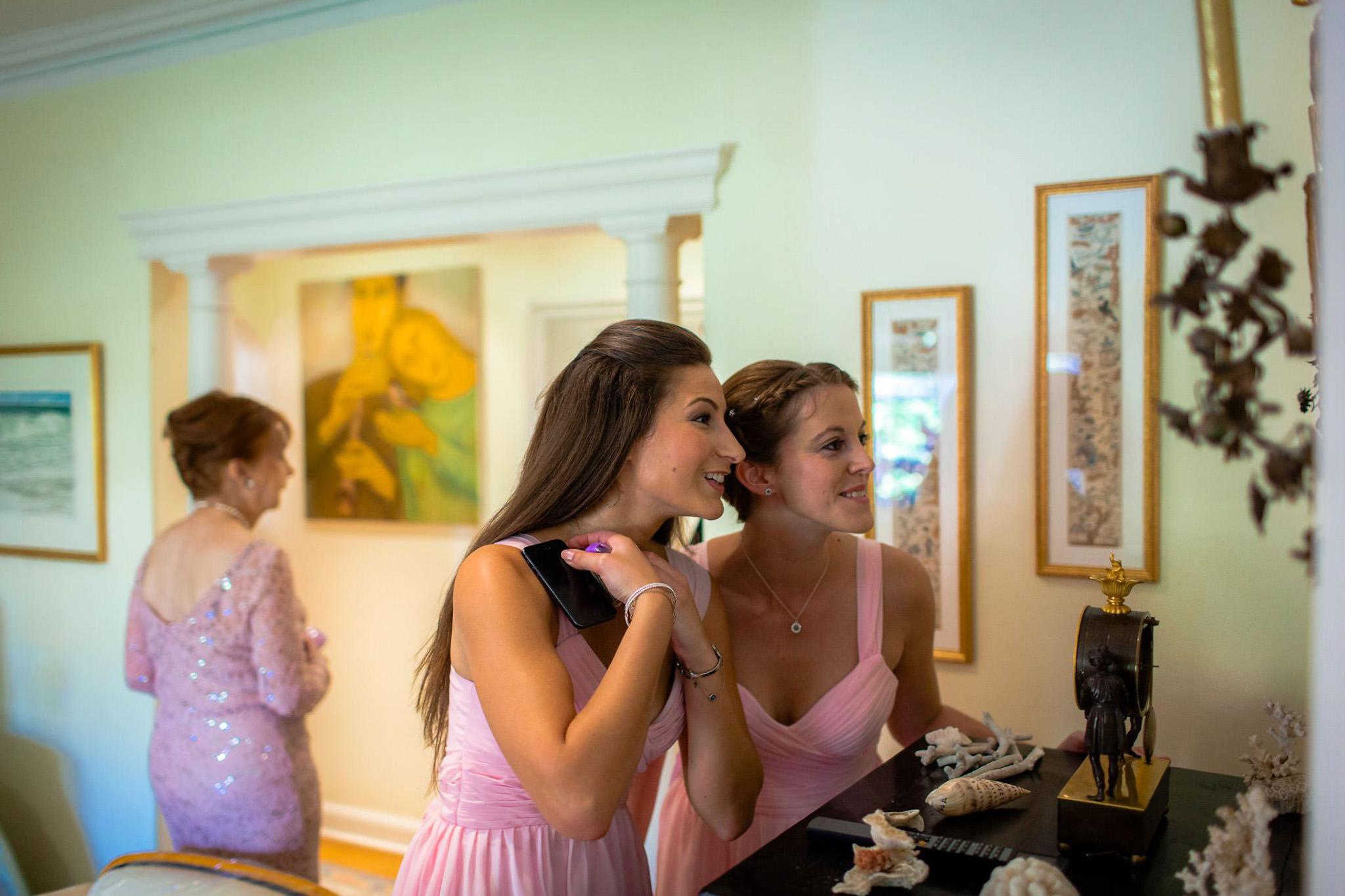 St. Pancras Renaissance hotel wedding bridesmaids looking in the mirror