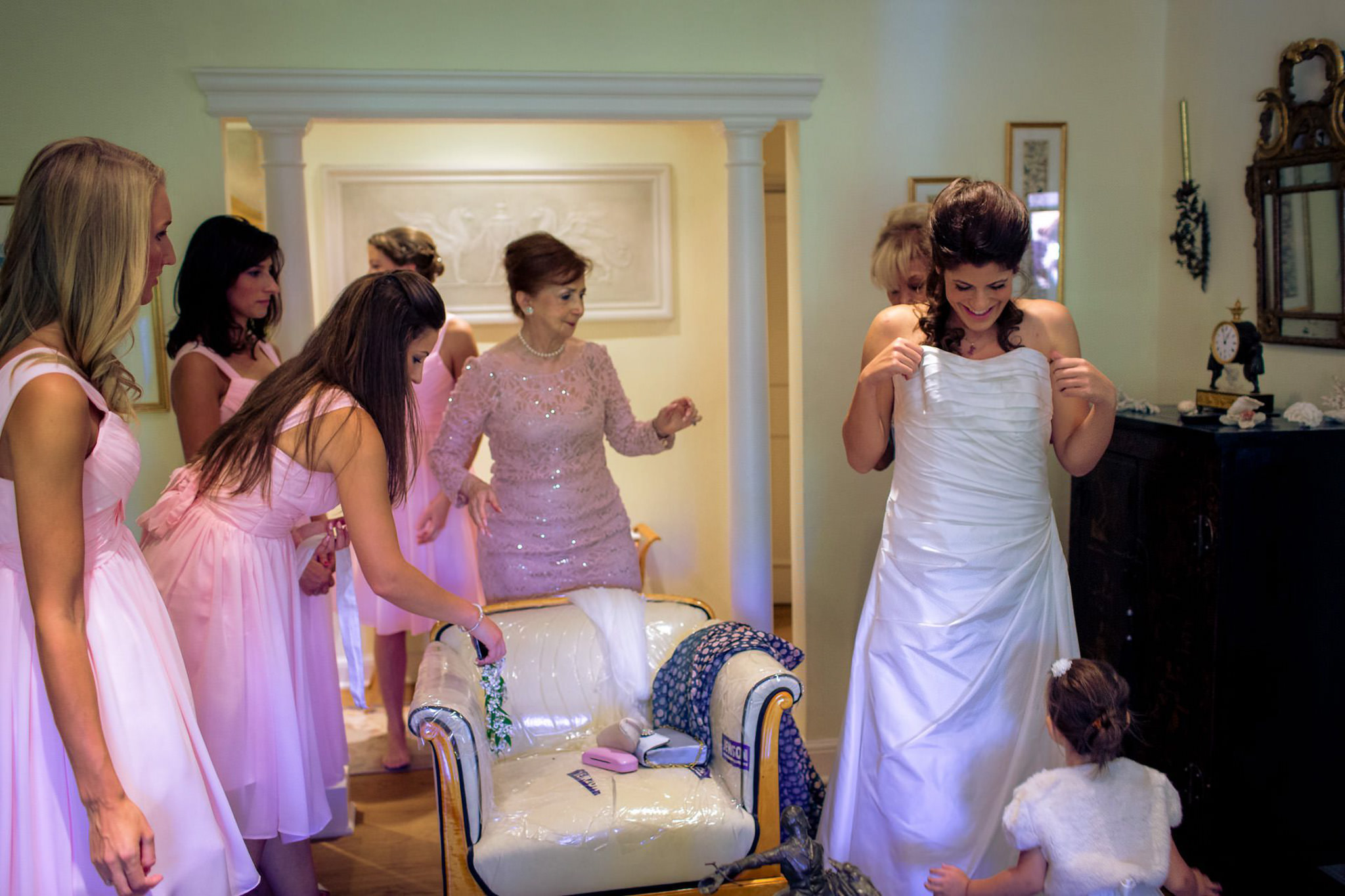 St. Pancras Renaissance hotel wedding bride getting into a dress