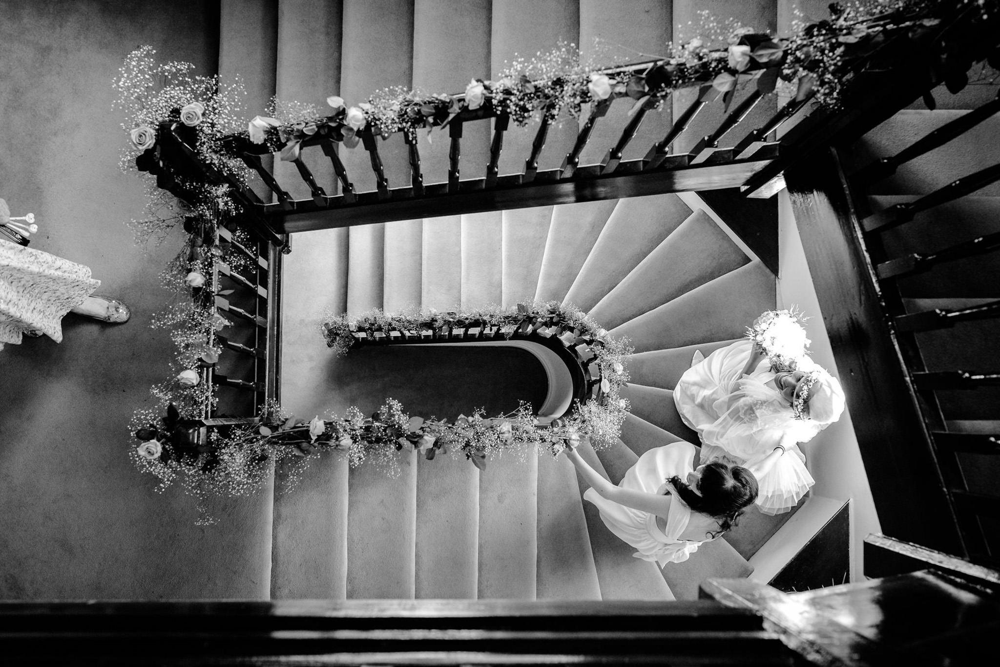 St. Pancras Renaissance hotel wedding bride walking down the stairs