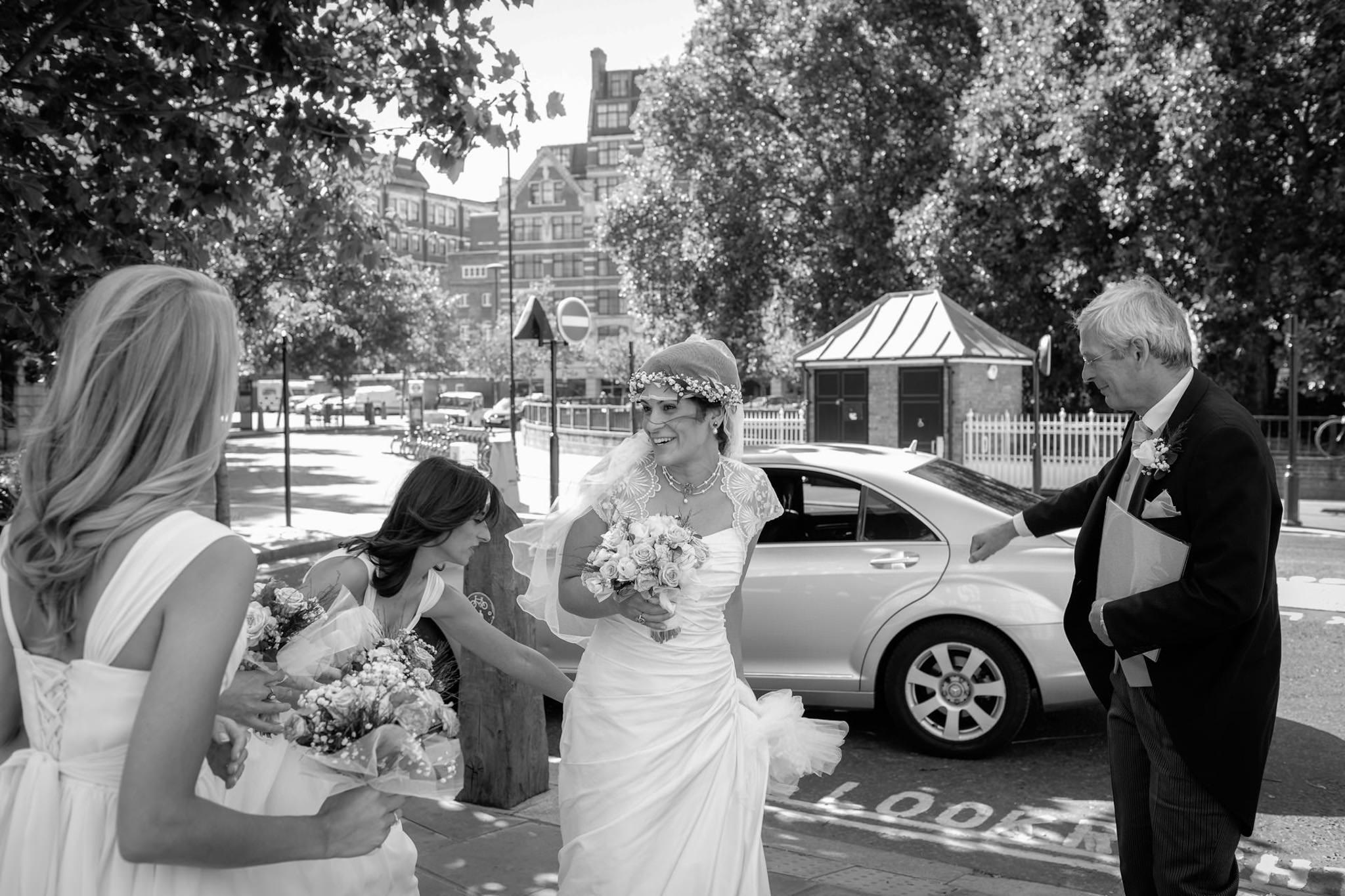 St. Pancras Renaissance hotel wedding bride getting of the car