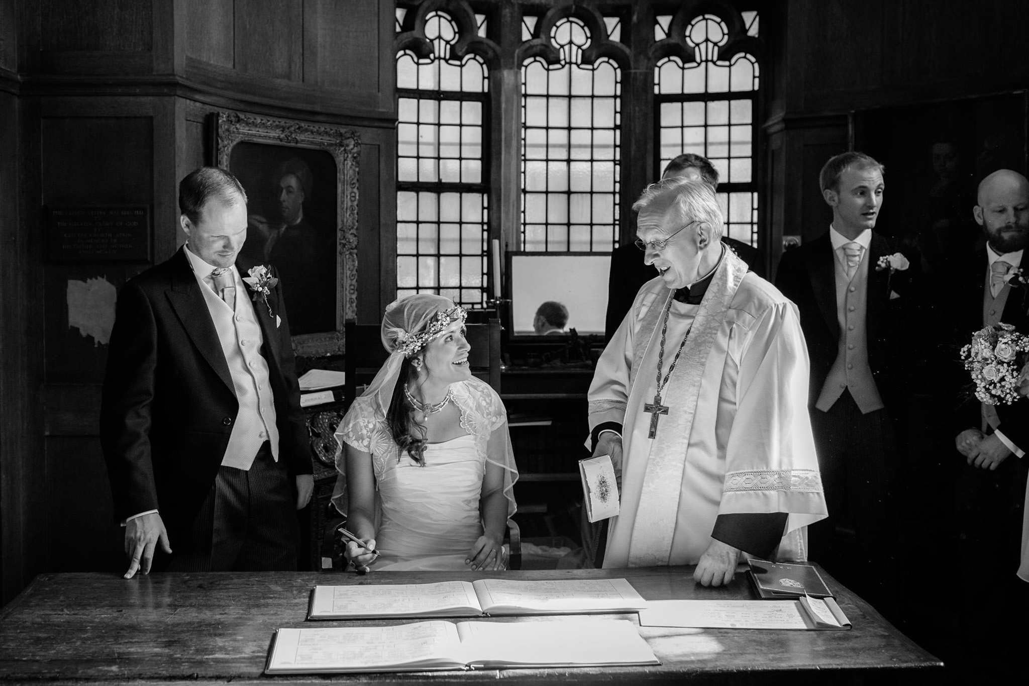 St. Pancras hotel wedding bride signing the registrar