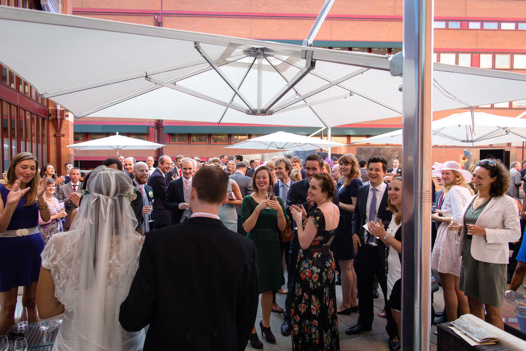 St. Pancras hotel wedding married couple enter reception