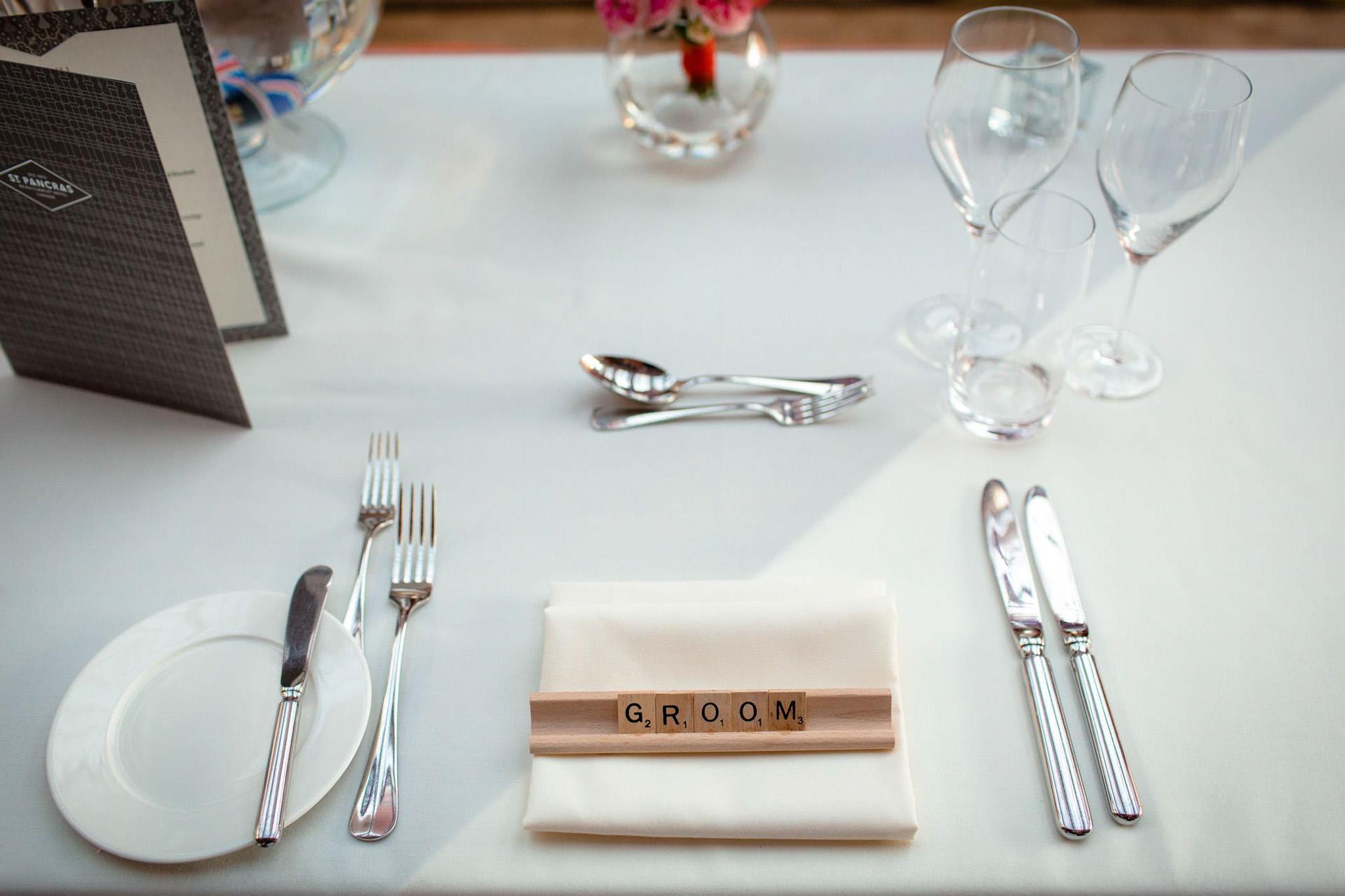 St. Pancras hotel wedding table details groom