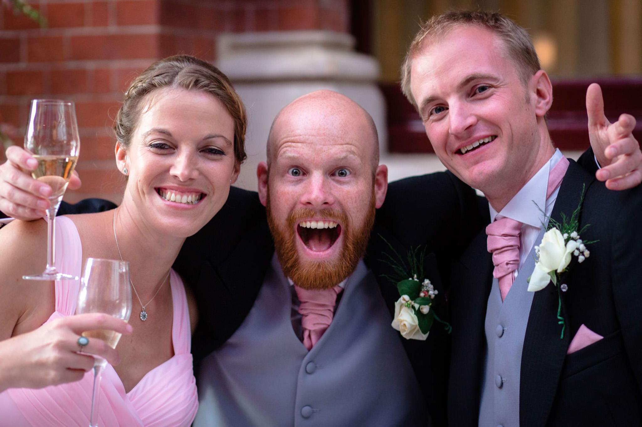 St. Pancras hotel wedding guests posing