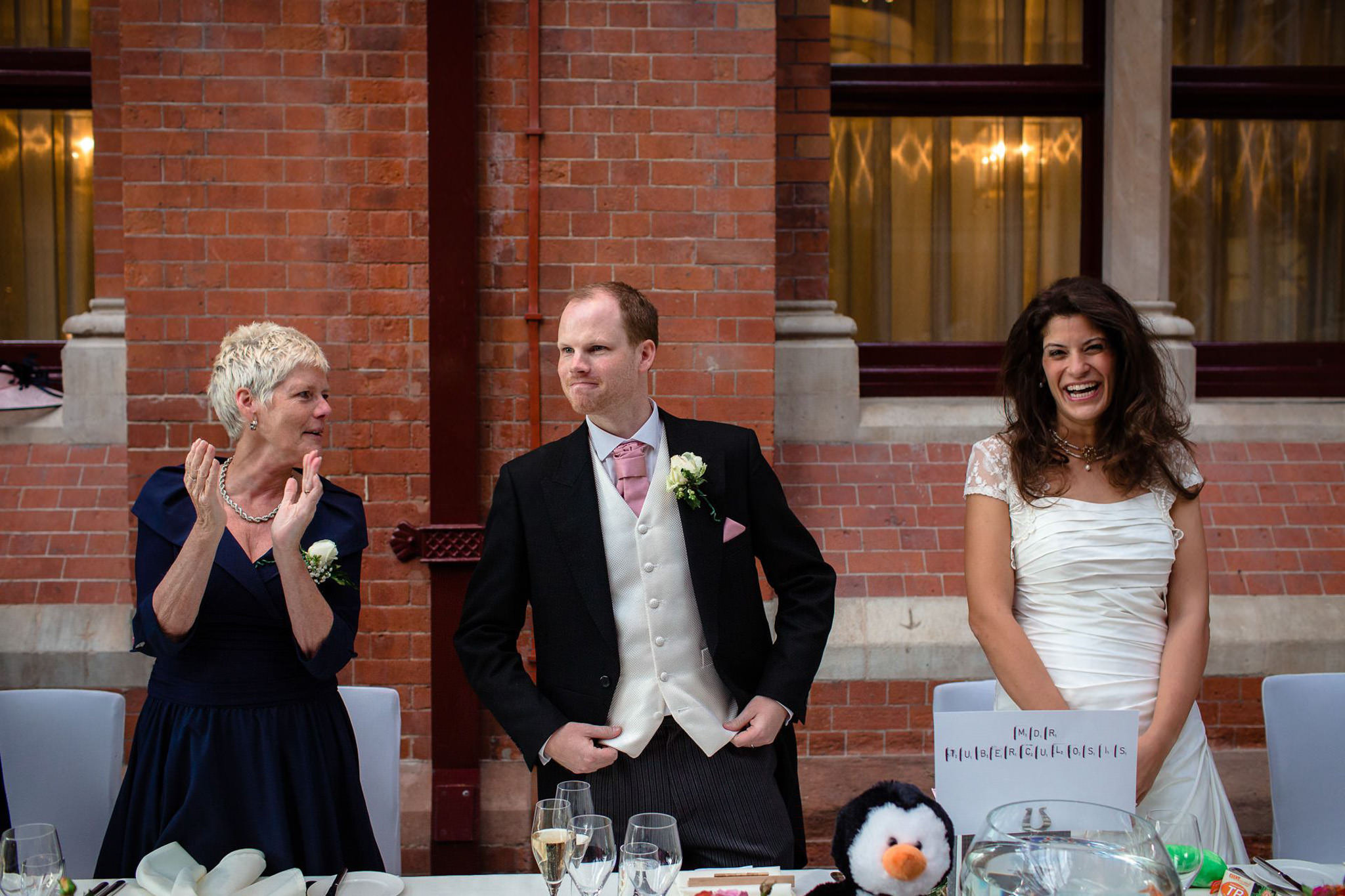 St. Pancras hotel wedding groom stand by the top table