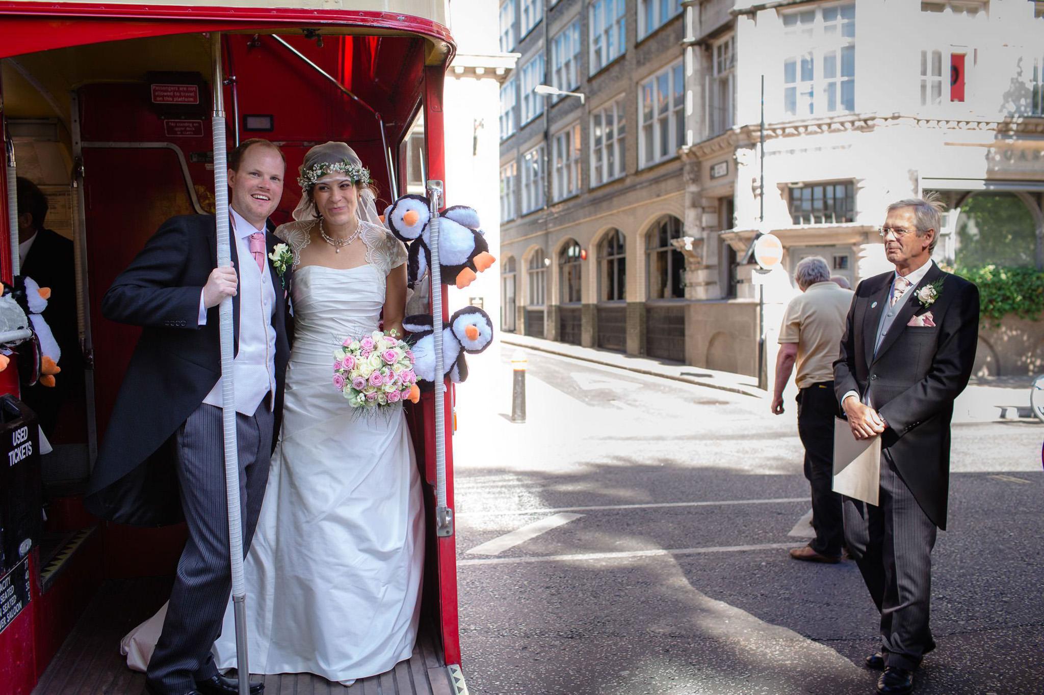 St. Pancras hotel wedding couple on the bus