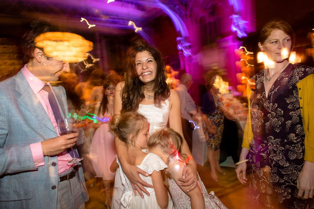 St. Pancras hotel wedding St. Pancras hotel wedding bride hugs kids