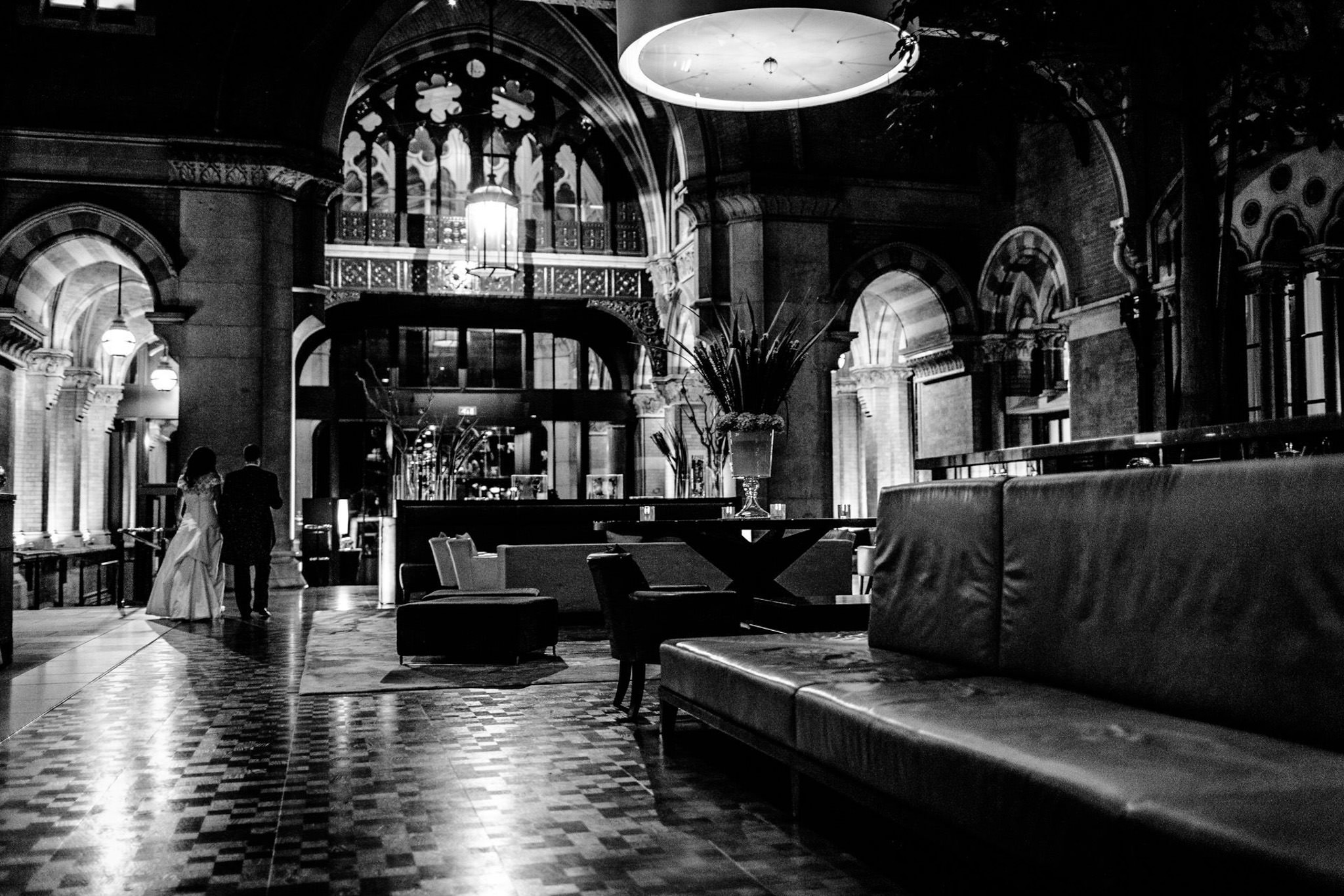 St. Pancras hotel wedding bride and goorm walk away into the future