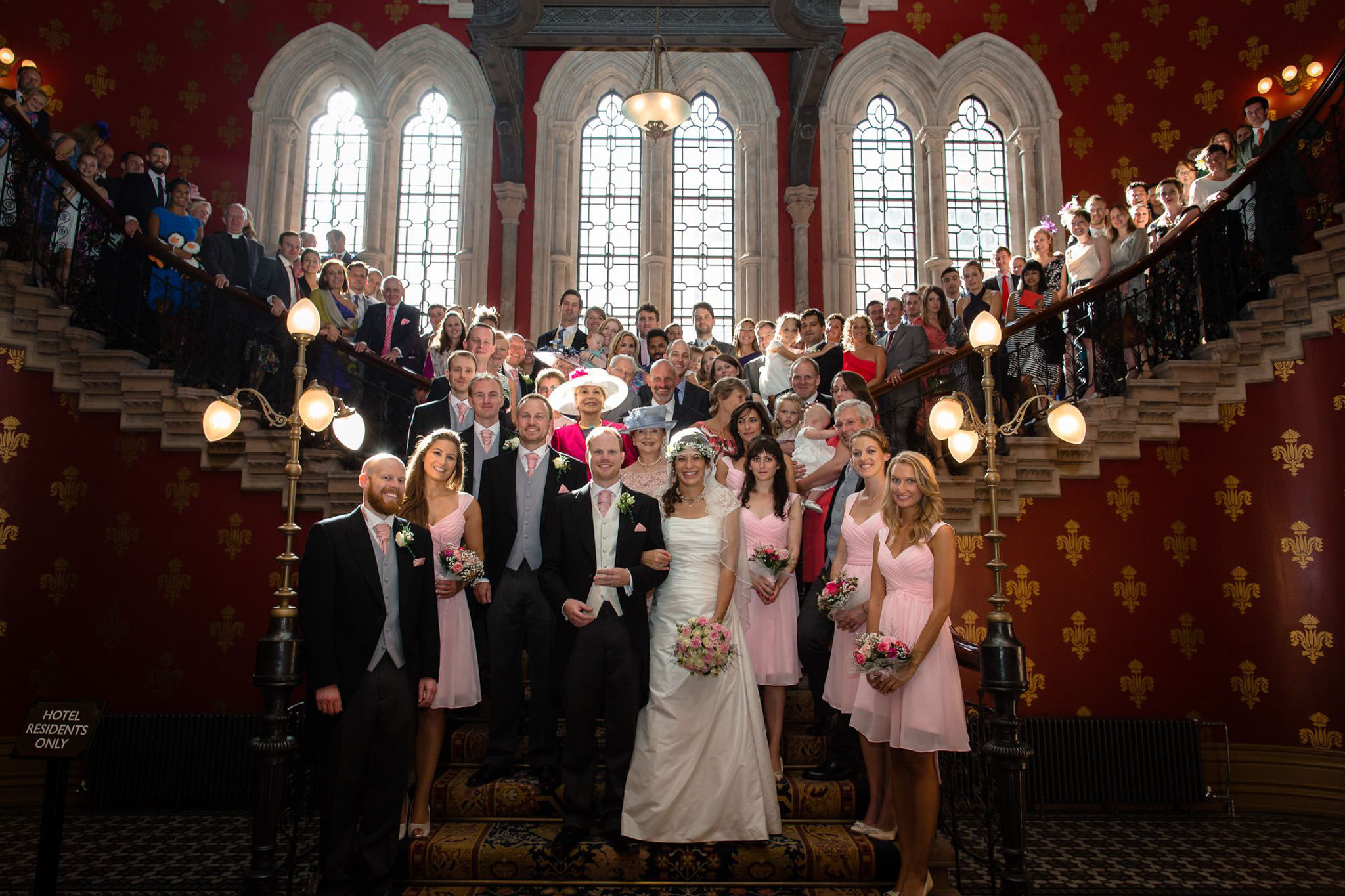 St. Pancras hotel wedding group photo on the staircase