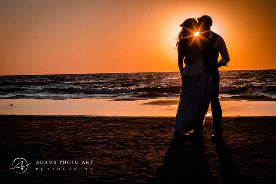 wedding photo session on the beach during the sunset