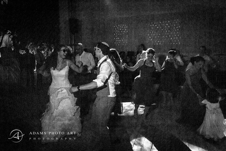 married couple dancing at their party