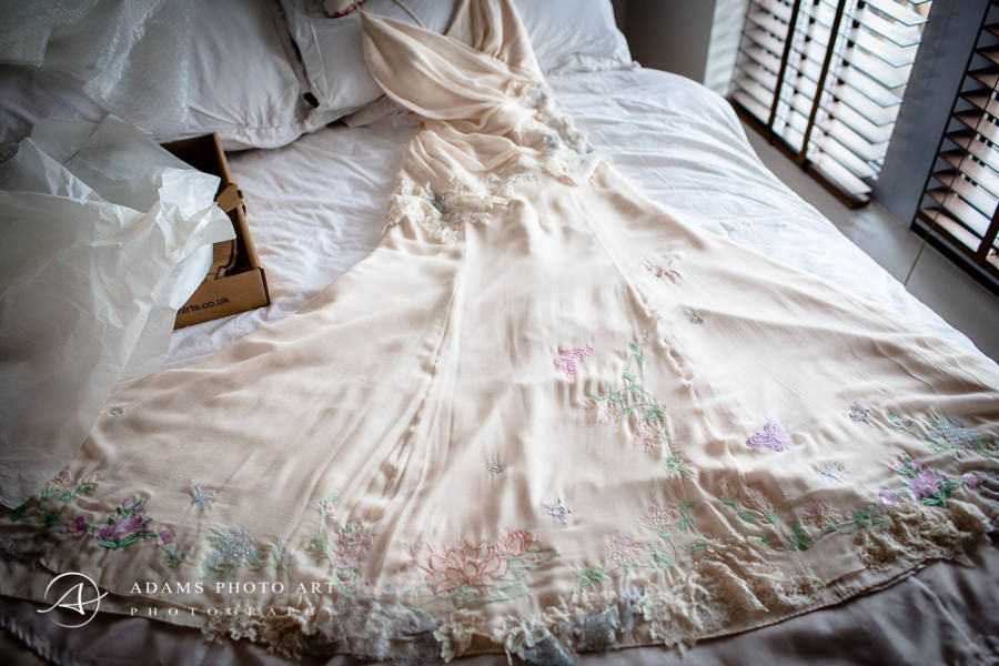 wedding dress at the bed
