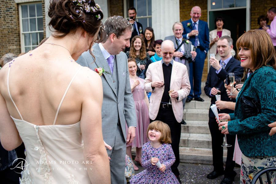 bride looks at the little girl