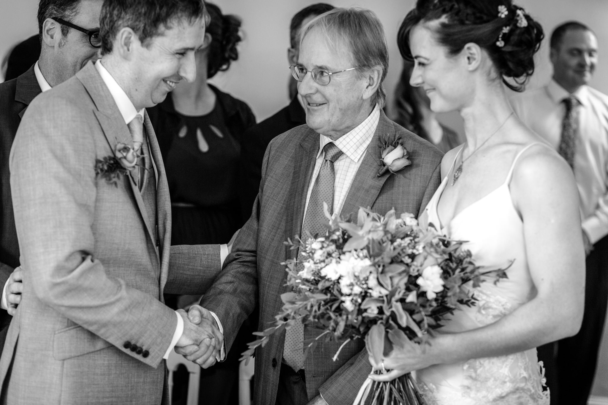 Clissold House wedding father of the bride shake hand with the groom