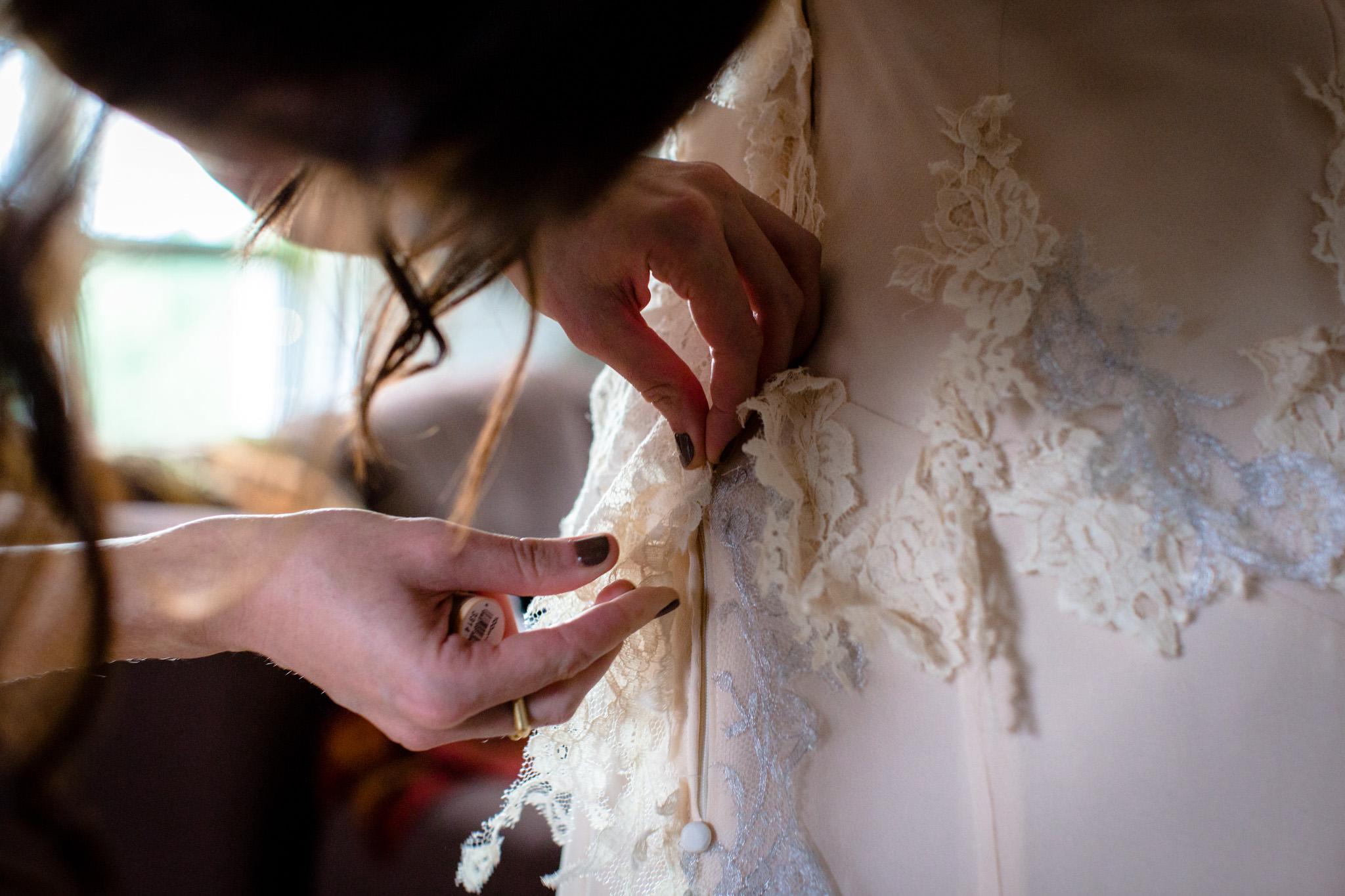 Clissold House wedding zipping up the dress