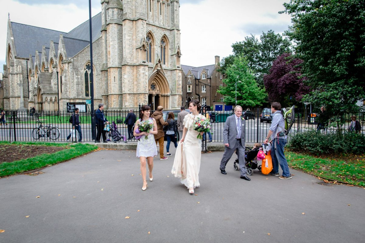 Clissold House wedding bride walks in front of the car
