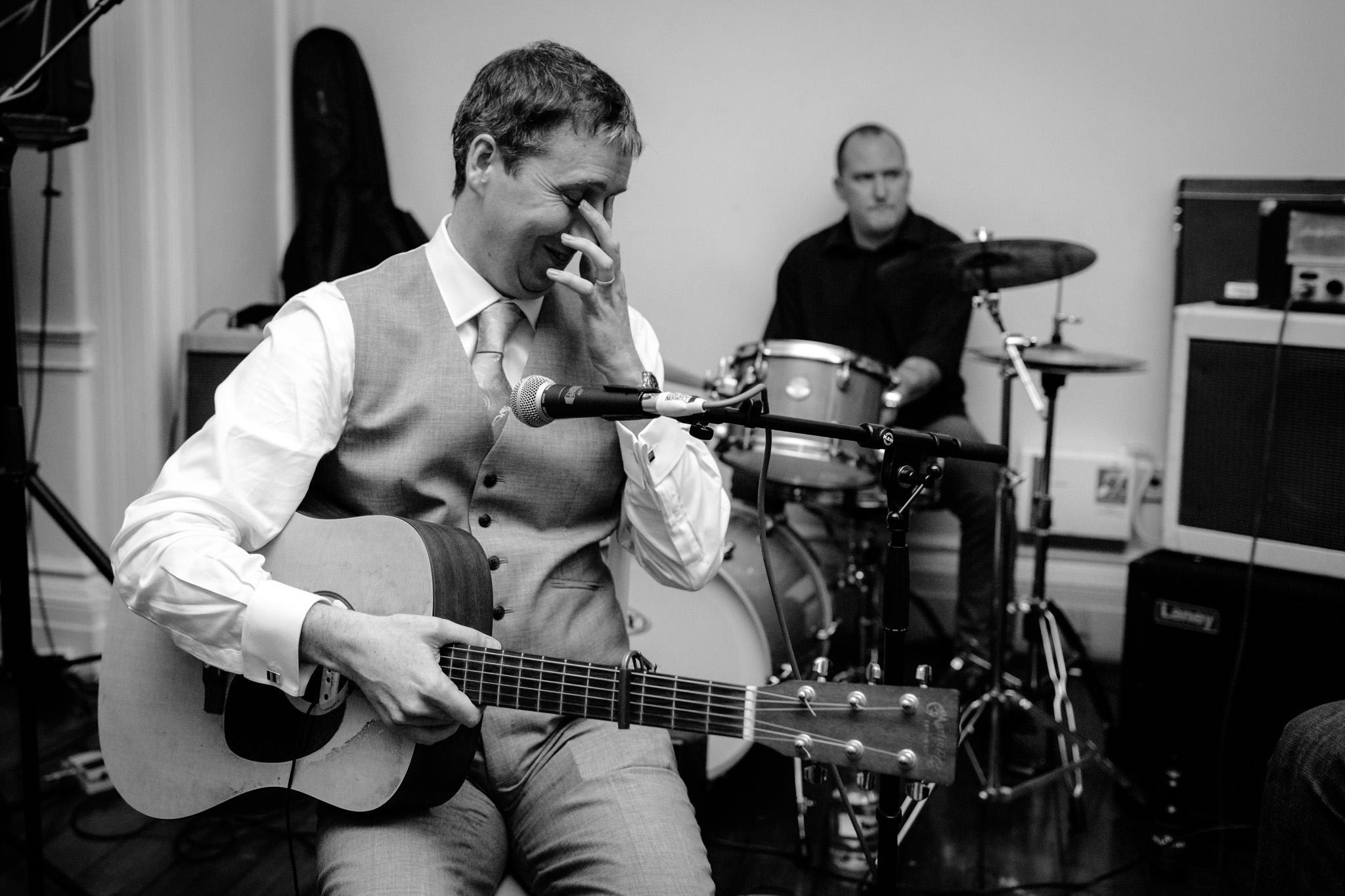 Clissold House wedding grom is about to play guitar