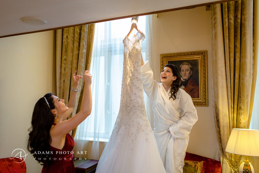 happy bride admires her wedding dress
