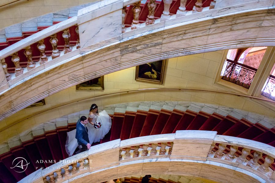 portrait of the young couple going up the stairs