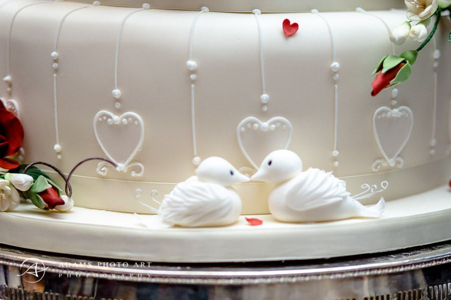 Sugar swans on wedding cake