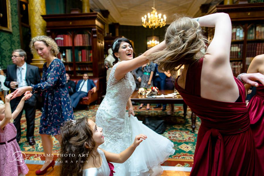 happy bride dancing at the wedding party in national liberal club