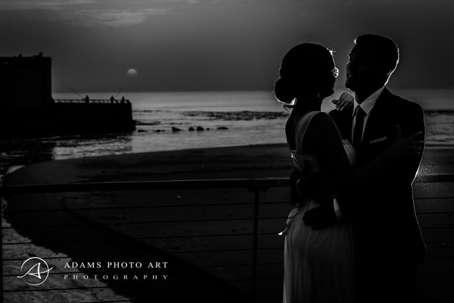 romantic wedding photo on the beach at night