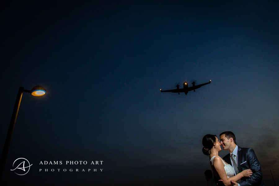 Kissing couple and plane in the background
