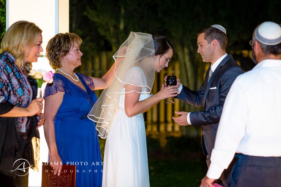part of the jewish wedding ceremony captured in documentary style