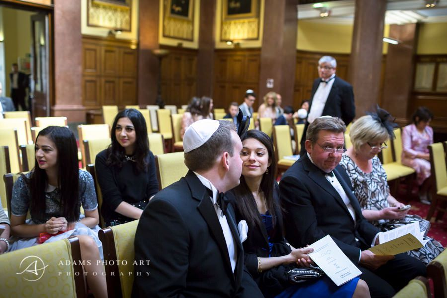 jewish wedding guests in the law society waiting for the ceremony