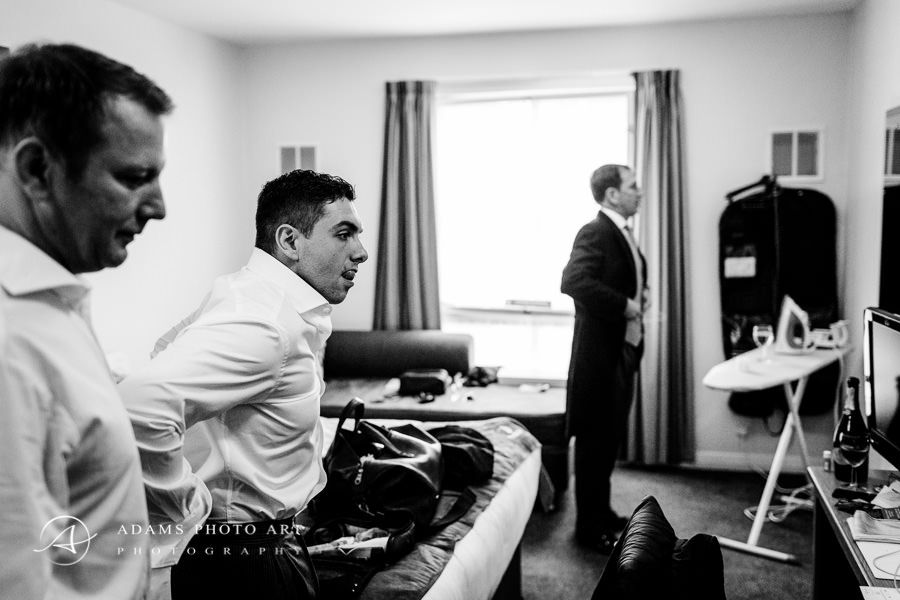 groom and groomsmen prepars for the ceremony