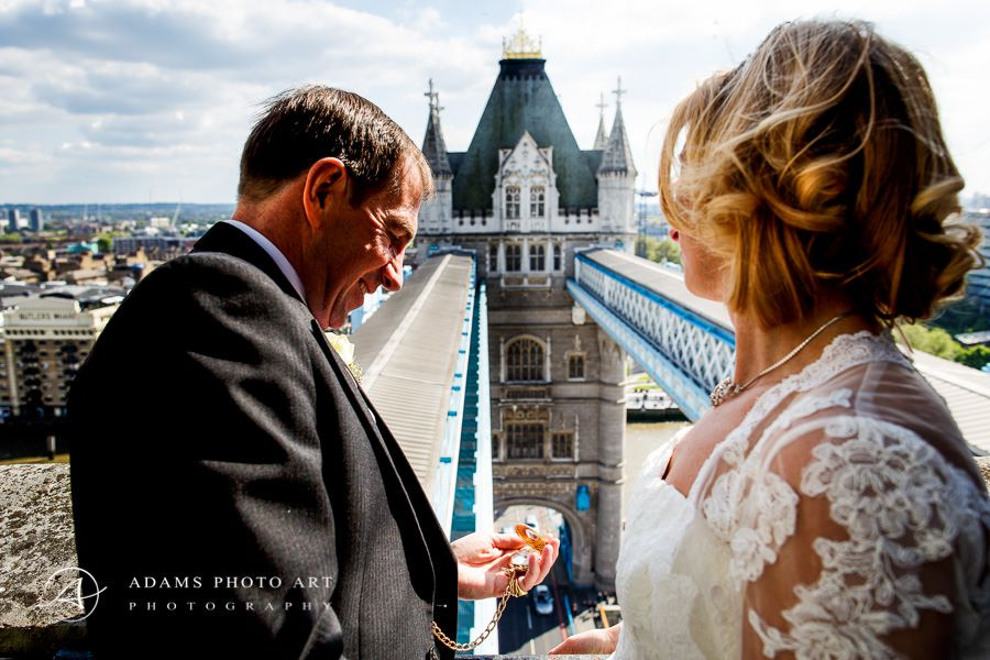 married couple mel and colin during their wedding photo session at the tower bridge in london