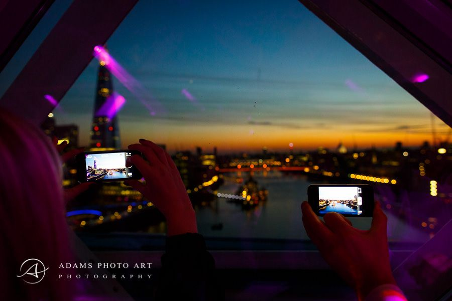 people taking picture od the london panorama