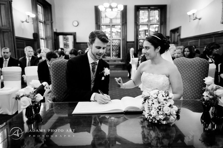 Young couple signing wedding act