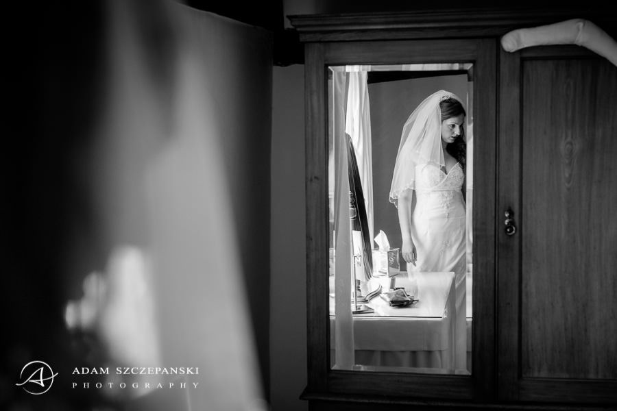 Reflection of the bride in the mirror while preparing for the wedding