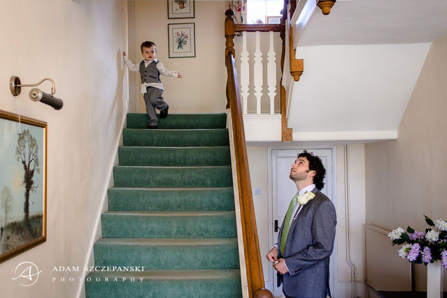 The man looks at the child descends the stairs
