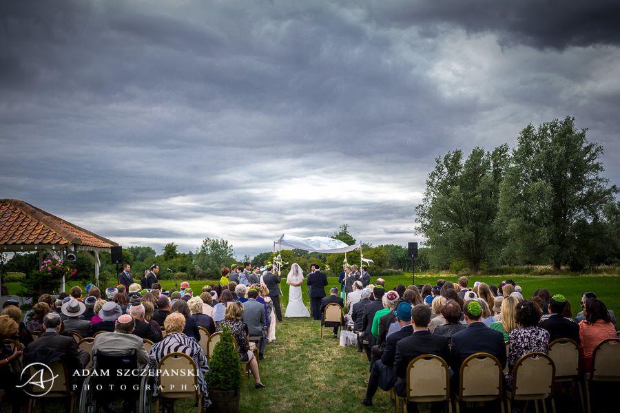 Jewish Chuppah wedding in the field under the sky