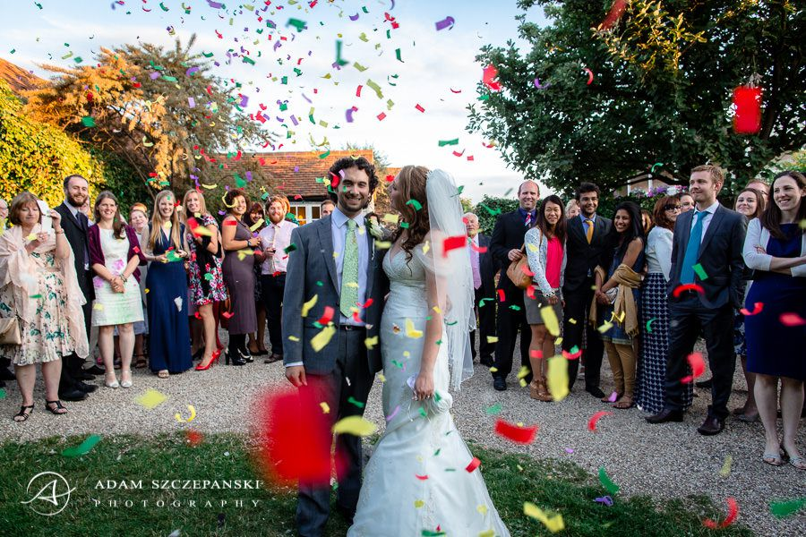 Young couple throwing confetti