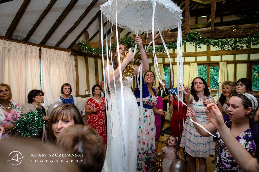 part of the jewish wedding traditions bride under umbrella
