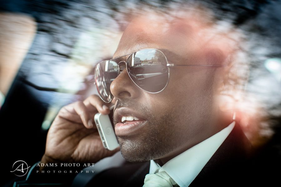 Northbrook Park Wedding Photographer groom talking on the phone