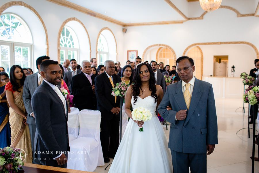 bride with her father going to the altar