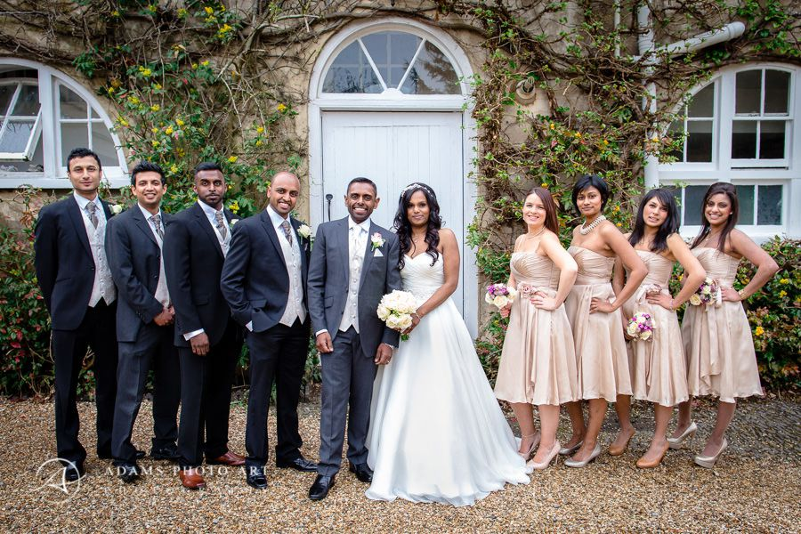 group photography of the married couple groomsmen and bridesmaids