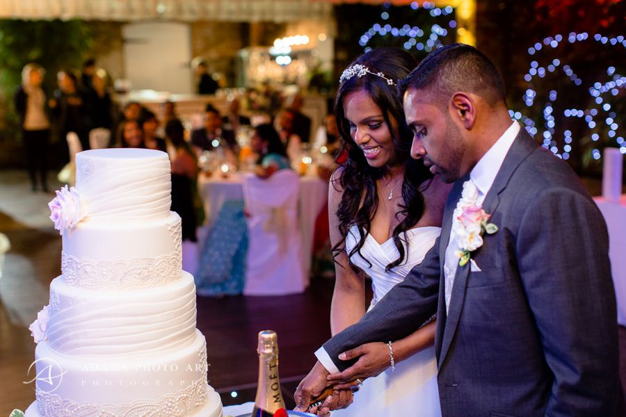 bharkavy and edwin cutting their wedding cake