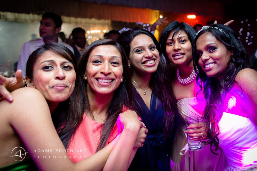 women at the party smiling to the photographer