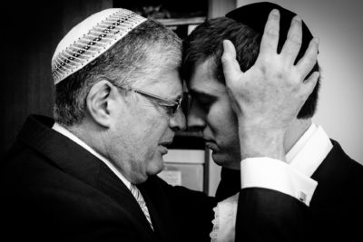 jewish blessing of the father during the wedding on the photography