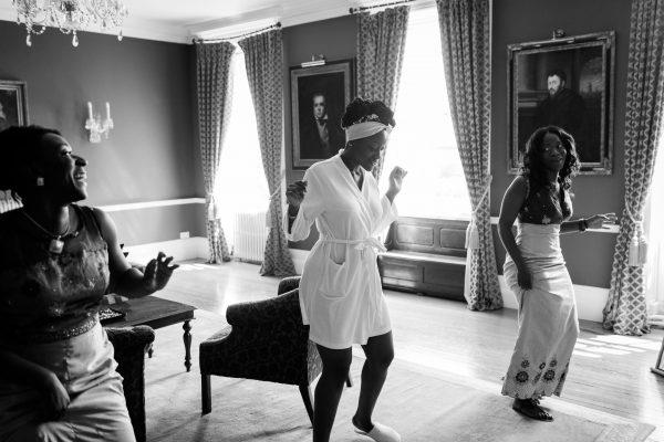 Addington Palace wedding bride and bridesmaids practicing dancing
