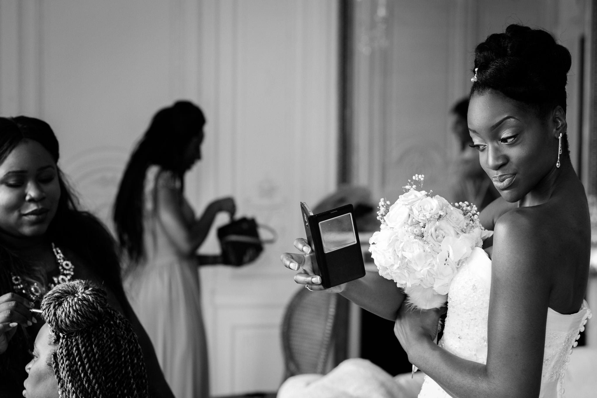 Addington Palace wedding bride looking in the mirror